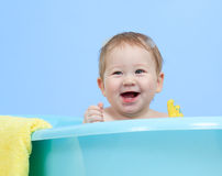 Adorable baby taking bath in blue tub Royalty Free Stock Image