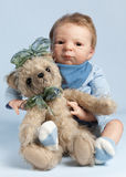 Adorable baby with teddy bear Stock Images