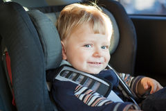 Adorable baby toddler in safety car seat Stock Photos