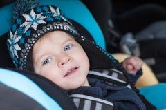 Adorable baby toddler in safety car seat Stock Photos