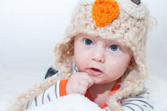 Adorable Baby Touching Face Owl Hat Stock Photography