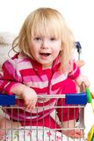 Adorable baby with toys in shop cart Stock Images