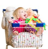 Adorable baby with toys in shop cart Royalty Free Stock Photo