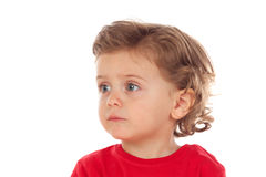 Adorable baby with two years old and red jersey looking to the s Royalty Free Stock Image