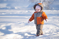 Adorable baby walk by lakes ice in park Stock Photos