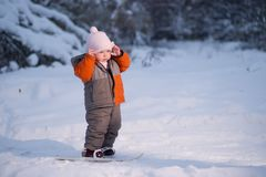 Adorable baby walk on ski in park Royalty Free Stock Image