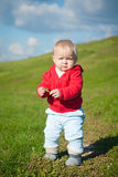 Adorable baby walking bay road on hill Stock Photos