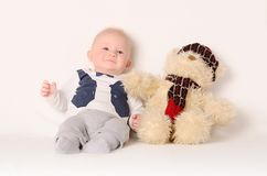 Adorable baby on white background with his friend Royalty Free Stock Photography