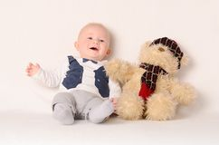 Adorable baby on white background with his friend Stock Image