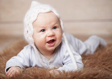 Adorable  baby in white hat Stock Image