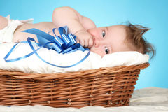 Adorable baby in wicker basket Stock Photography