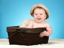 Adorable baby in wicker basket Royalty Free Stock Image
