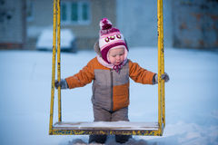 Adorable baby on winter playground Stock Photography