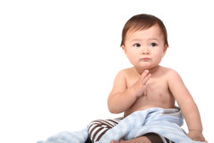 Adorable baby wrapped in blanket stock photo
