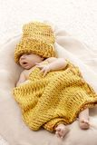Adorable baby in yellow knitwear Stock Photos