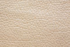 Adorable beige dermatin background. Beige leather texture. High resolution photo stock image