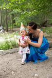 Adorable birthday girl child year-old with mother in park at summer Royalty Free Stock Photography