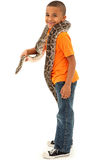 Adorable Black Boy Holding pet Boa Constrictor Stock Photos