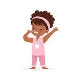 Adorable black cartoon girl in a pink pajamas brushing her teeth, kids dental care vector Illustration Stock Photos