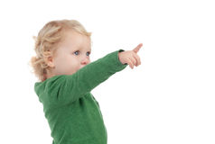 Adorable blond baby indicating something Stock Photos