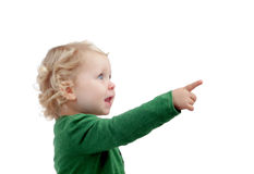 Adorable blond baby indicating something Royalty Free Stock Images