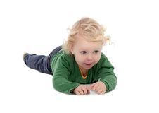 Adorable blond baby lying on the floor Royalty Free Stock Image