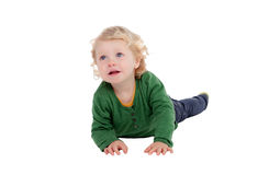 Adorable blond baby lying on the floor Royalty Free Stock Photos