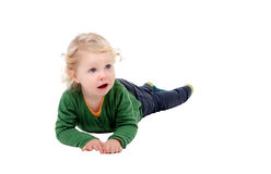 Adorable blond baby lying on the floor Royalty Free Stock Photo