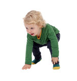 Adorable blond baby standing up Royalty Free Stock Images
