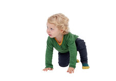 Adorable blond baby standing up Stock Photo