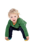 Adorable blond baby touching his feet Royalty Free Stock Images