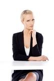 Adorable blond business woman sitting at desk Stock Images