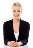 Adorable blond business woman sitting at desk Royalty Free Stock Photos