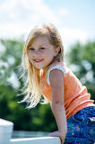 Adorable blond child on fence Stock Photo