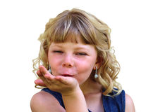 Adorable Blond Girl Blowing a Kiss Royalty Free Stock Images