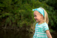 Adorable blond girl laughing Stock Photography