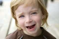 Adorable blond little girl crying portrait Stock Images