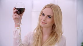 Adorable Blond Woman Rising Her Glass stock video footage