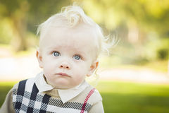 Adorable Blonde Baby Boy Outdoors at the Park Stock Photos