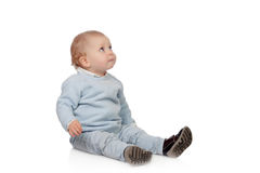 Adorable blonde baby sit on the floor Stock Photo