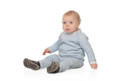 Adorable blonde baby sit on the floor Royalty Free Stock Photos