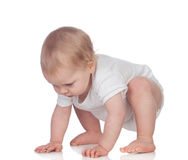 Adorable blonde baby in underwear crawling Royalty Free Stock Photography