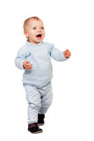 Adorable blonde baby walking Stock Image