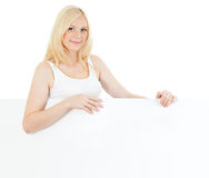 Adorable blonde girl displaying big copyspace Royalty Free Stock Images