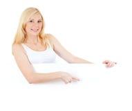 Adorable blonde girl displaying big copyspace Royalty Free Stock Photos