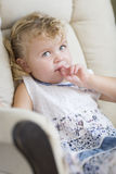 Adorable Blonde Haired and Blue Eyed Little Girl in Chair Royalty Free Stock Photos
