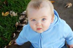 Adorable Blue Eyed Baby. Blue eyed Baby Boy sitting Outside Royalty Free Stock Images