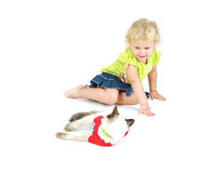 Adorable blue-eyed blonde girl. Playing with pet Stock Photos