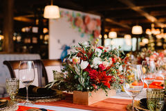 Adorable bouquet on luxury prepeared event table Royalty Free Stock Images