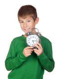 Adorable boy with a alarm-clock Royalty Free Stock Photo